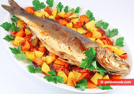 Спигола (сибас) запечённая с травами и овощами